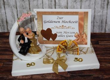 geld geschenk zur goldenen hochzeit mit goldpaar auf schaukel. Black Bedroom Furniture Sets. Home Design Ideas
